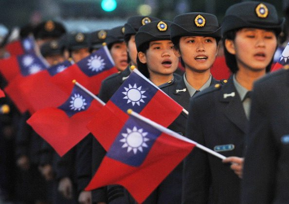 Students of a military school wave the Taiwan's national flag during a ceremony at the Presidential Office Square in Taipei on January 1, 2013. (Mandy Cheng/AFP/Getty Images)