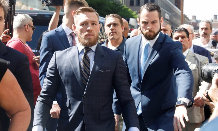 MMA fighter Conor McGregor leaves Brooklyn Supreme Court after facing a hearing on assault charges in Brooklyn, New York, U.S., June 14, 2018. (Reuters/Shannon Stapleton)