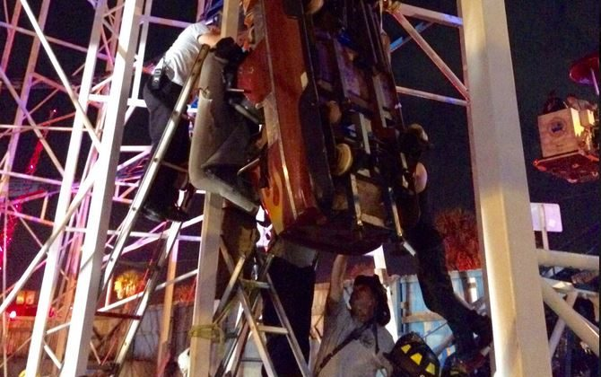 DB Firefighters working as fast as they can to rescue 2 riders that are in a dangling rollercoaster car. (Daytona Beach Fire Department/screenshot)