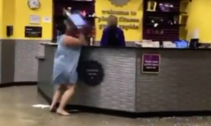 Woman arrested after wild fit of rage at Michigan Planet Fitness. (Screenshot via Fox News)