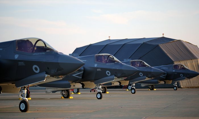 F-35B Lightning II fighter jets arrive at the Royal Air Force Marham airbase in Kings Lynn, England on June 6, 2018. A former British engineer is suspected of transmitting technology related to the jets to China. (Christopher Furlong/Getty Images)