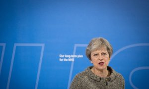 British PM Pledges Extra 20 Billion Pounds to Health Care, but Questions Remain