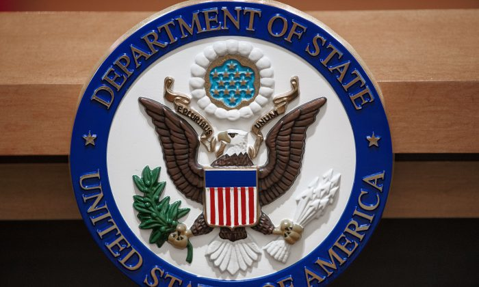 The US Department of State seal is seen on the podium-lectern area in the State Department briefing room in Washington in 2013. (Paul J. richards/AFP/Getty Images)
