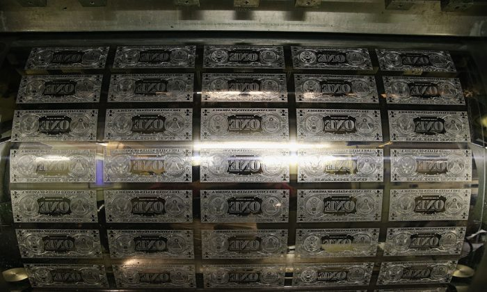 One dollar bill printing plates are ready to print money at the Bureau of Engraving and Printing in Washington, D.C., on March 24, 2015. (Photo by Mark Wilson/Getty Images)