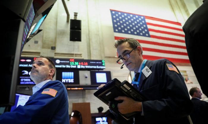 Traders and financial professionals work ahead of the closing bell on the floor of the New York Stock Exchange (NYSE), June 15, 2018 in New York City. (Drew Angerer/Getty Images)