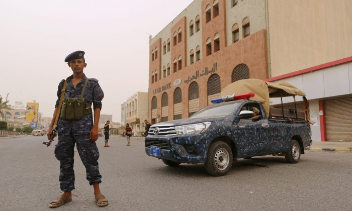 A pro-Houthi police trooper stands past a patrol vehicle in the Red Sea port city of Hodeidah, Yemen June 14, 2018. (Reuters/Abduljabbar Zeyad)