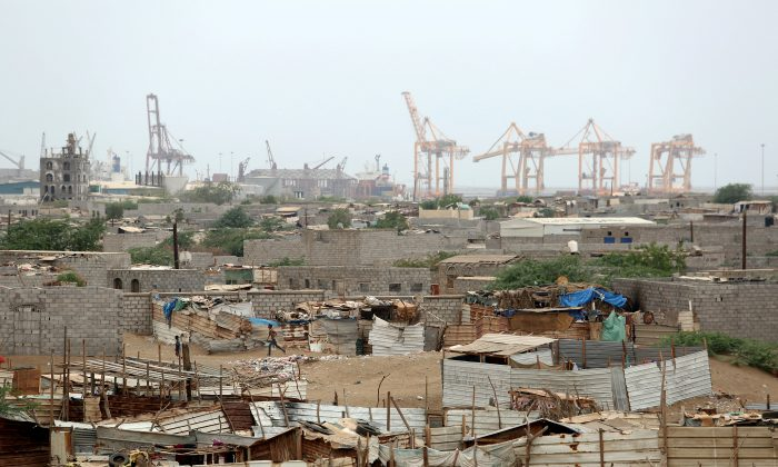 Hodeidah port's cranes are pictured from a nearby shantytown in Hodeidah, Yemen on June 16, 2018. (Reuters/Abduljabbar Zeyad)