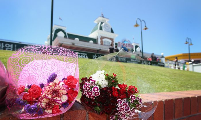Flowers can be seen at the entrance to Dreamworld on Oct. 25, 2017 in Gold Coast, Australia, after four people were killed on a ride. (Jono Searle/Getty Images)