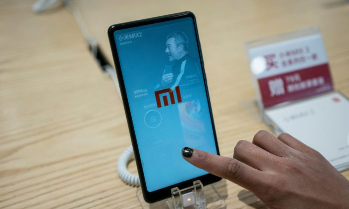 A Xiaomi smartphone is displayed in a shop in Beijing on May 2, 2018. (Fred Dufour/AFP/Getty Images)