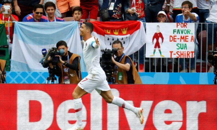 Soccer Football - World Cup - Group B - Portugal vs Morocco - Luzhniki Stadium, Moscow, Russia - June 20, 2018   Portugal's Cristiano Ronaldo celebrates scoring their first goal. (REUTERS/Kai Pfaffenbach)