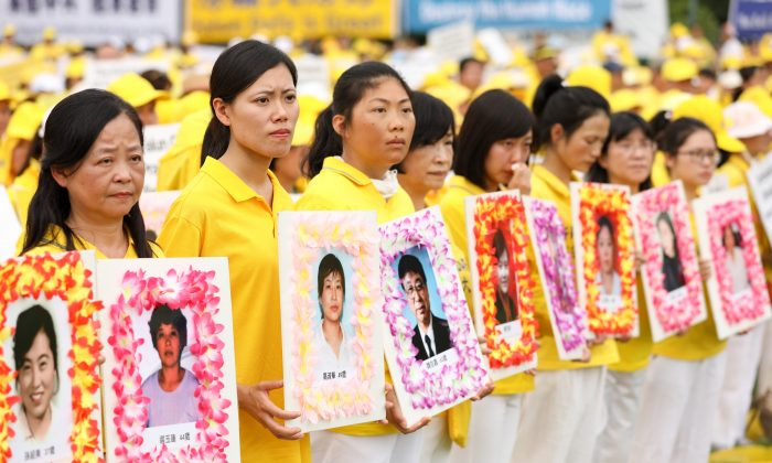 Falun Gong practitioners commemorate the deaths adherents who were persecuted to death by the Chinese regime, during a march down Pennsylvania Ave. in Washington, D.C. on June 20, 2018. (Samira Bouaou/The Epoch Times)