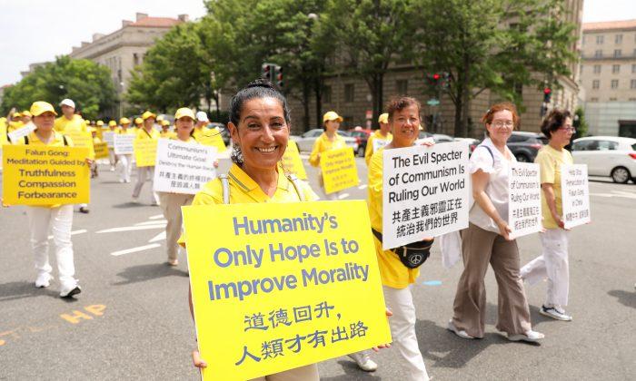 Falun Gong practitioner from Australia joins a Falun Dafa march in Washington on June 20, 2018. (Samira Bouaou/The Epoch Times)
