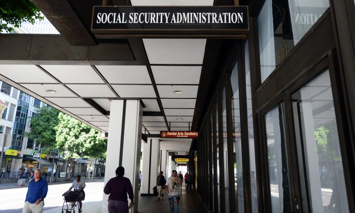 Pedestrians walk past the Social Security Administration office in downtown Los Angeles on Oct. 1, 2013. (Fredericc J. Brown/AFP/Getty Images)