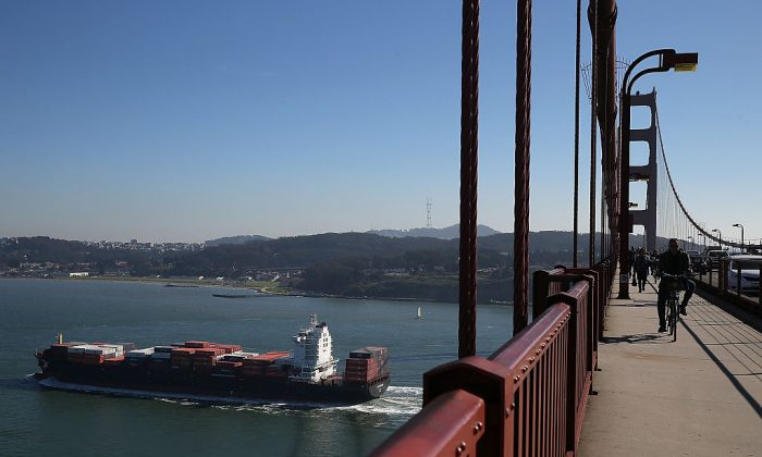 A container ship passes under the Golden Gate Bridge into the San Francisco Bay enroute to the Port of Oakland in San Francisco, California, on Feb. 20, 2015. (Justin Sullivan/Getty Images)