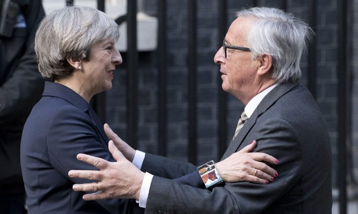 European Commission President, Jean-Claude Juncker (R) is greeted by British Prime Minister Theresa May outside 10 Downing Street in London on April 26, 2017. (Justin Tallis/AFP/Getty Images)