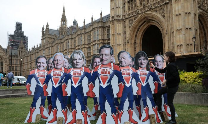 """Pressure Group Avaaz stage a Brexit vote protest urging 12 Tory rebels to be """"superheroes"""" by voting to overturn government plans on June 20, 2018 in London, England. (Dan Kitwood/Getty Images)"""