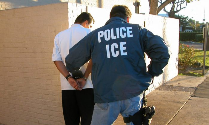 An Immigration and Customs Enforcement agent conducts an arrest in this file photo. (ICE)