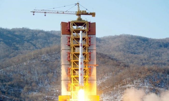 A North Korean long-range rocket is launched into the air at the Sohae rocket launch site, North Korea, in this photo released by Kyodo Feb. 7, 2016.(REUTERS/Kyodo)