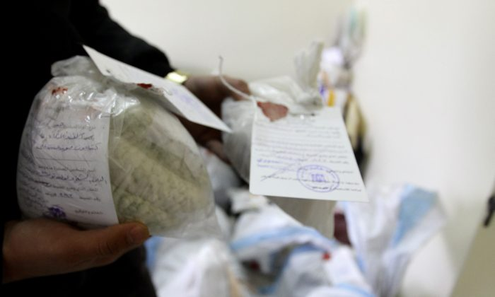 In a file photo, Syrian police show seized captagon pills at the Drug Enforcement Administration in the capital Damascus, on Jan. 4, 2016. (Louai Beshara/AFP/Getty Images)