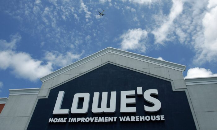 A sign on the exterior of a Lowe's home improvement warehouse store in San Bruno, California, on May 22, 2006. (Justin Sullivan/Getty Images)