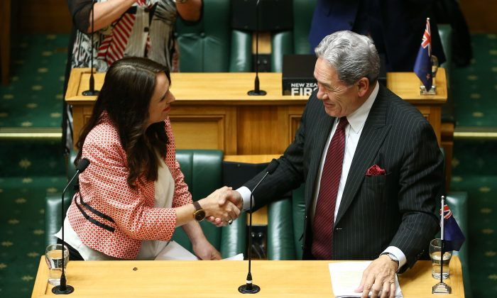 New Zealand Prime Minister Jacinda Ardern (L) shakes hands with Deputy Prime Minister Winston Peters after her speech during the 2018 budget presentation at Parliament on May 17, 2018 in Wellington, New Zealand. (Hagen Hopkins/Getty Images)