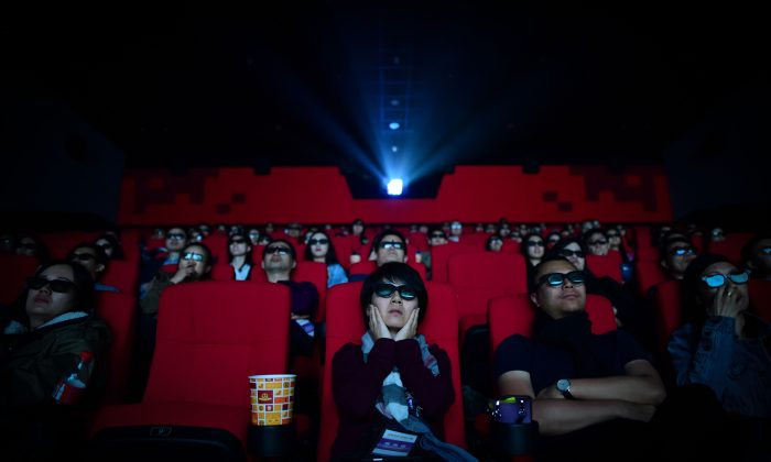 This file photo shows people watching a movie at the Wanda Group's Oriental Movie Metropolis movie theater in Qingdao City, Shandong Province on April 27, 2018. (Wang Zhao/AFP/Getty Images)