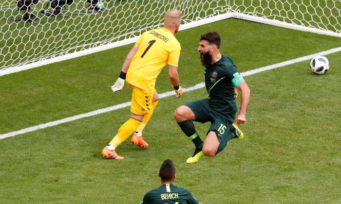 Australia's Mile Jedinak celebrates scoring their first goal on June 21, 2018.  (Reuters/David Gray)