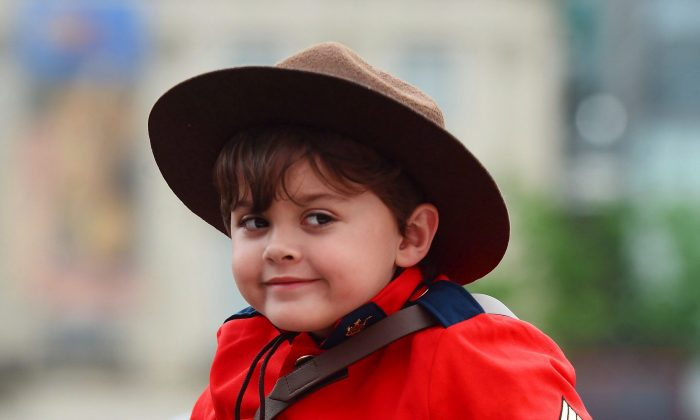 A youngster dressed like a Mountie takes part in the Canada Day celebrations on Parliament Hill on July 1, 2017. (The Canadian Press/Sean Kilpatrick)