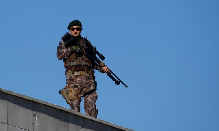 A member of police special forces stands guard during a trial for soldiers accused of attempting to assassinate Turkish President Tayyip Erdogan on the night of the failed last year's July 15 coup, in Mugla, Turkey, Oct. 4, 2017. (Reuters/Osman Orsal)