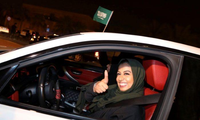 A Saudi woman celebrates as she drives her car in her neighborhood, in Al Khobar,  Saudi Arabia, June 24, 2018. (Reuters/Hamad I Mohammed)