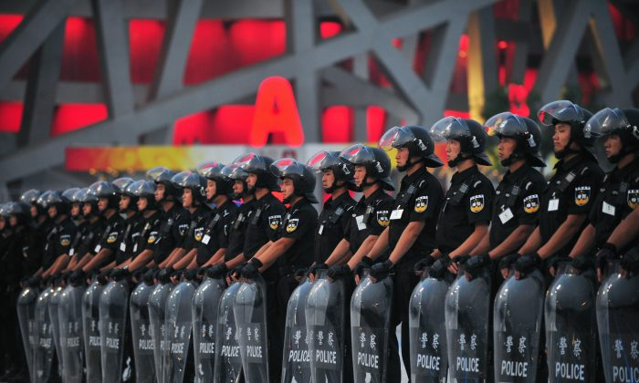 Members of a police SWAT team line up outside the main Beijing Olympic Stadium during security drill rehearsals on July 23, 2008. (Frederic J. Brown/AFP/Getty Images)