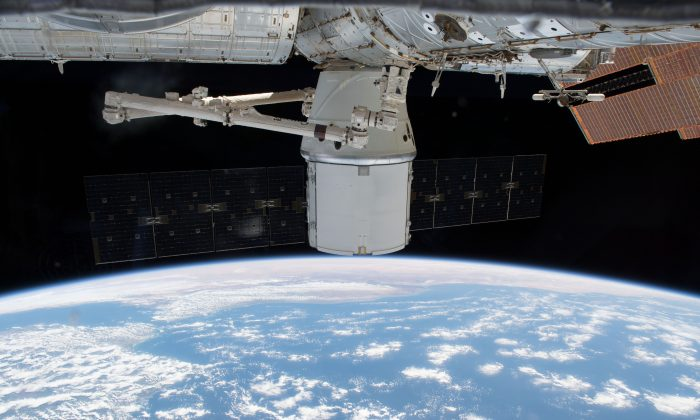The SpaceX Dragon resupply ship was gripped by the Canadarm2 robotic arm on April 27, 2018 in preparation for its detachment from the Harmony module on the International Space Station. (Photo by NASA)