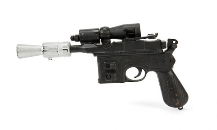 "The BlasTech DL-44 blaster used by Han Solo, played by Harrison Ford, from the Star Wars trilogy film ""Return of the Jedi."" (Julien's Auctions/Handout via REUTERS)"