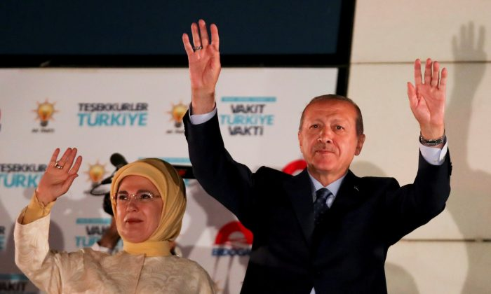 Turkish President Tayyip Erdogan and his wife Emine Erdogan greet supporters gathered in front of the AKP headquarters in Ankara, Turkey June 25, 2018. (Reuters/Umit Bektas)