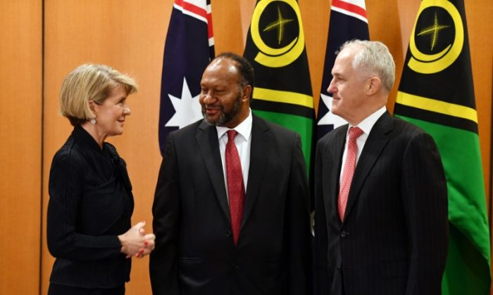 Vanuatu Prime Minister Charlot Salwai speaks to Australian Foreign Minister Julie Bishop and Australian Prime Minister Malcolm Turnbull before a bilateral meeting at Parliament House in Canberra, Australia, on June 25, 2018. (Mick Tsikas/Reuters)