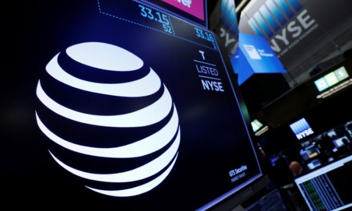 The AT&T logo is seen on a monitor on the floor of the New York Stock Exchange (NYSE) in New York City. June 13, 2018.  (REUTERS/Brendan McDermid)