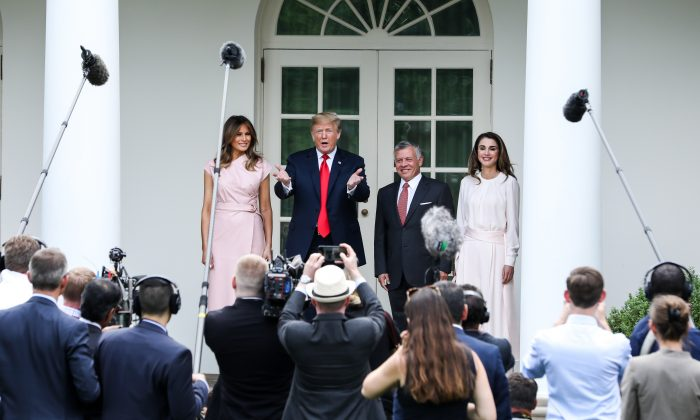 President Donald Trump and First Lady Melania Trump participate in the arrival of King Abdullah II bin Al-Hussein and Queen Rania Al Abdullah of the Hashemite Kingdom of Jordan at the White House in Washington on June 25, 2018. (Samira Bouaou/The Epoch Times)