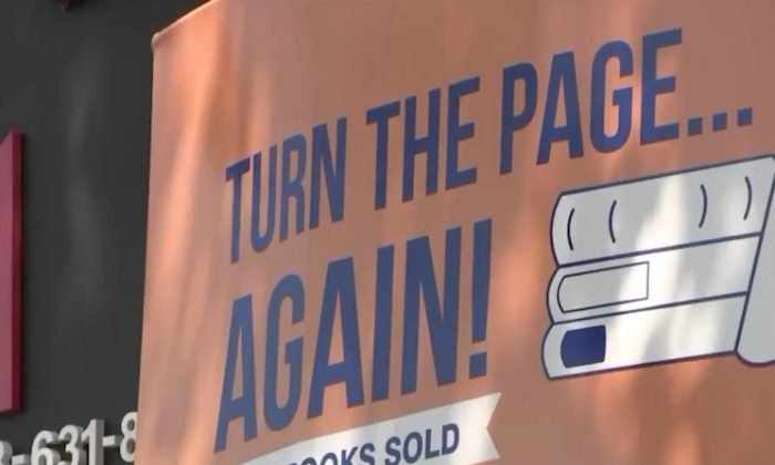 The sign outside Turn the Page Again in Bayside, Queens. (Pix 11/screenshot)