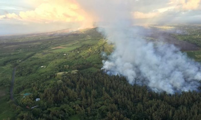 Fissure 8 continues to feed lava into multiple flow lobes advancing to agricultural land toward the northeast, as shown in this aerial view from a helicopter overflight in the vicinity of Kapoho Crater, Hawaii, June 1, 2018. (USGS/Handout via REUTERS)