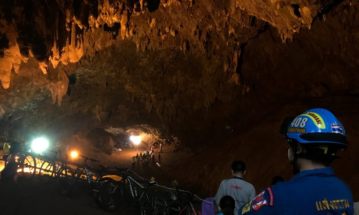 Rescue teams are seen inside of the Tham Luang caves where 13 members of an Under 16 soccer team were trapped in the northern province of Chiang Rai, Thailand, June 25, 2018. (Reuters/Stringer)