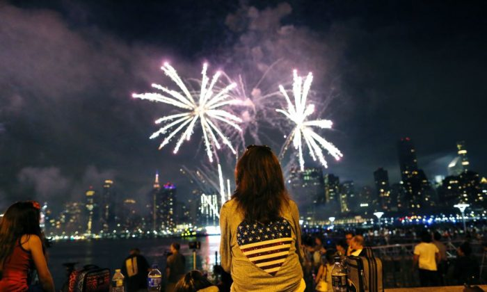 People watch the annual Macy's 4th of July fireworks show from Queens, New York on July 4, 2017. (Eduardo Munoz Alvarez/AFP/Getty Images)