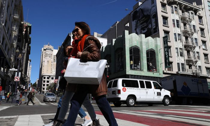 A shopper carries a shopping bag while walking in the Union Square district in San Francisco, California, on February 27. The U.S. consumer confidence index surged to 130.80 in February, its highest level since November 2000. (Justin Sullivan/Getty Images)