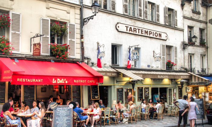 For citizens and tourists alike, the city's sidewalk bistros and cafes are emblematic of Paris. (Nicolasdecorte/Shutterstock)