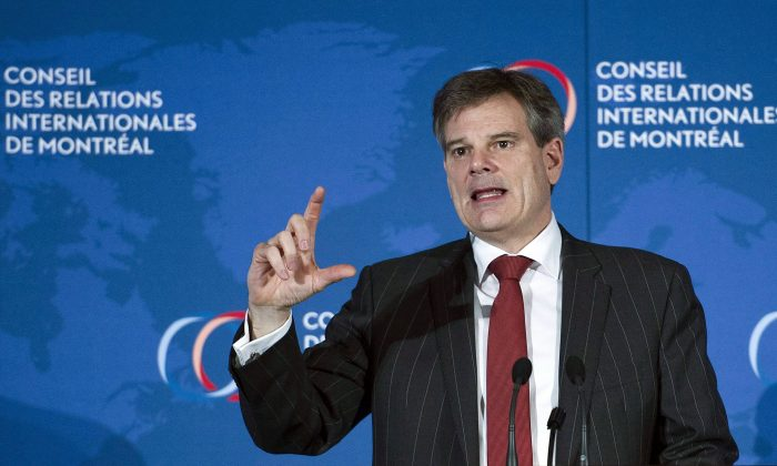 Export Development Canada president and CEO Benoit Daignault speaks during a business luncheon in Montreal on April 15, 2015. (The Canadian Press/Graham Hughes)