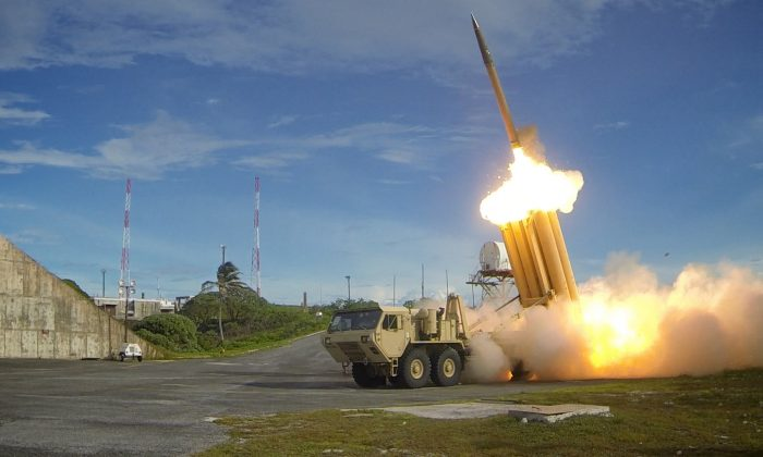A Terminal High Altitude Area Defense system (THAAD) is seen firing an intercepter in a Department of Defense photo. (DoD photo)