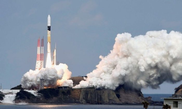 A H-IIA rocket carrying Hayabusa 2 space probe blasts off from the launching pad at Tanegashima Space Center on the Japanese southwestern island of Tanegashima, in this photo taken by Kyodo Dec. 3, 2014. (Kyodo via Reuters/File Photo)