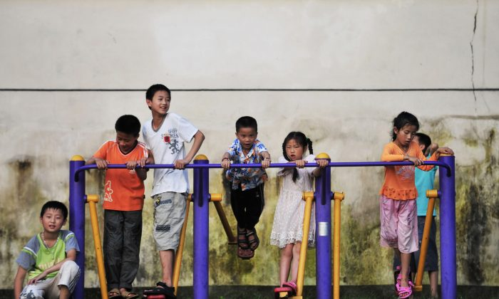 Children play in a university campus in Fuzhou City, Jiangxi Province, China, on June 27, 2010. (STR/AFP/Getty Images)