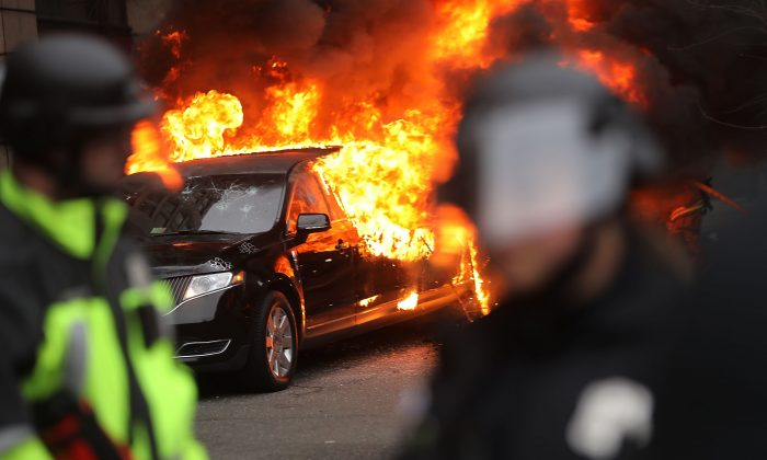 Police and demonstrators clash in downtown Washington after a limo was set on fire following the inauguration of President Donald Trump on January 20, 2017 in Washington, DC. (Spencer Platt/Getty Images)