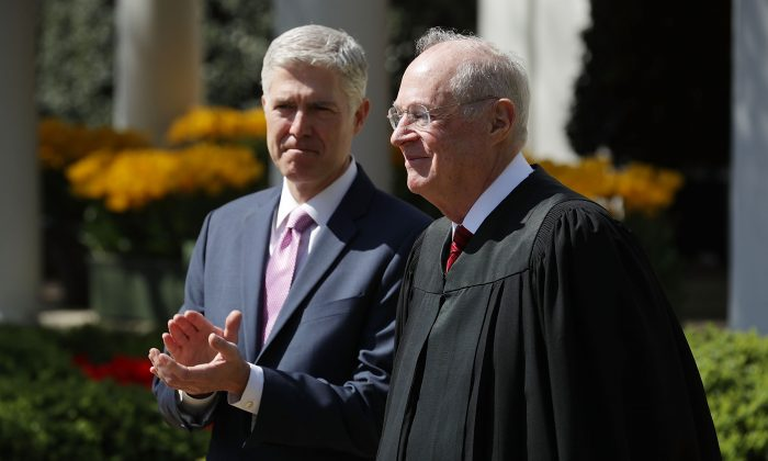 U.S. Supreme Court Associate Justice Anthony Kennedy (R) prepares to administer the judicial oath to Judge Neil Gorsuch during a ceremony in the Rose Garden at the White House in Washington on April 10, 2017. (Chip Somodevilla/Getty Images)