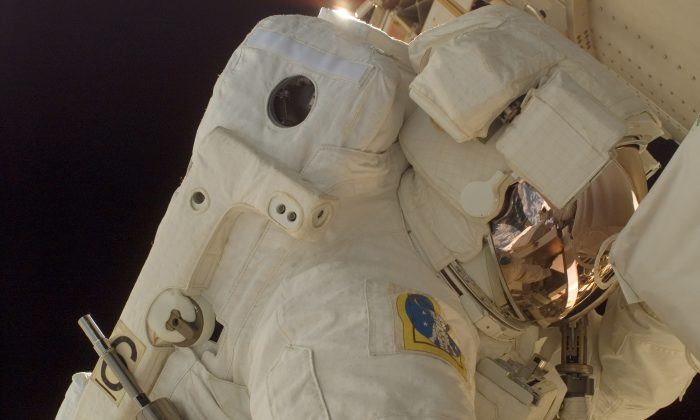 Army astronaut Col. Doug Wheelock, STS-120 mission specialist, on his first spacewalk to perform work on the International Space Station on Nov. 2, 2007. (Photo by NASA)